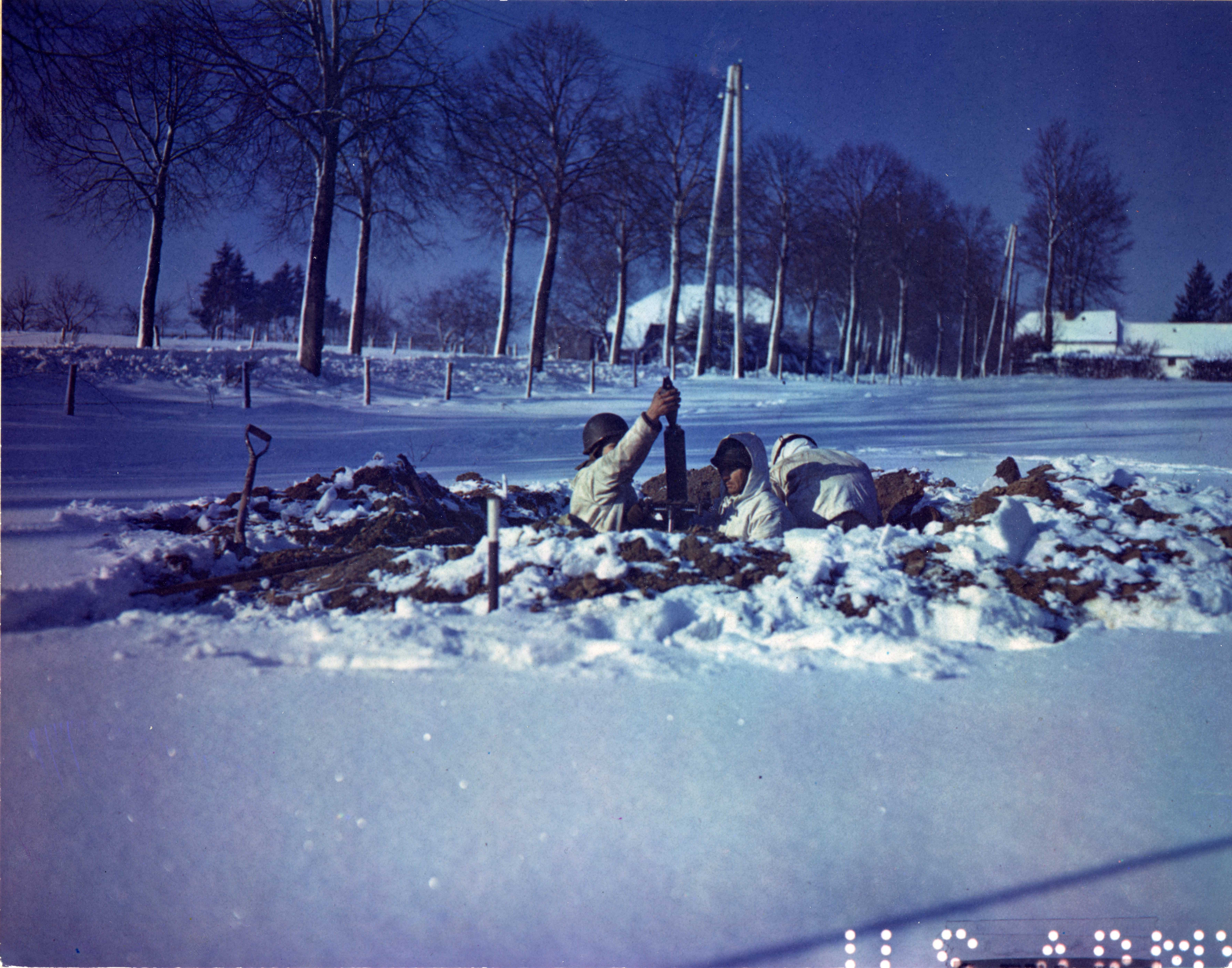 American Soldiers Man a Dug-In Mortar Emplacement near St. Vith, Belgium