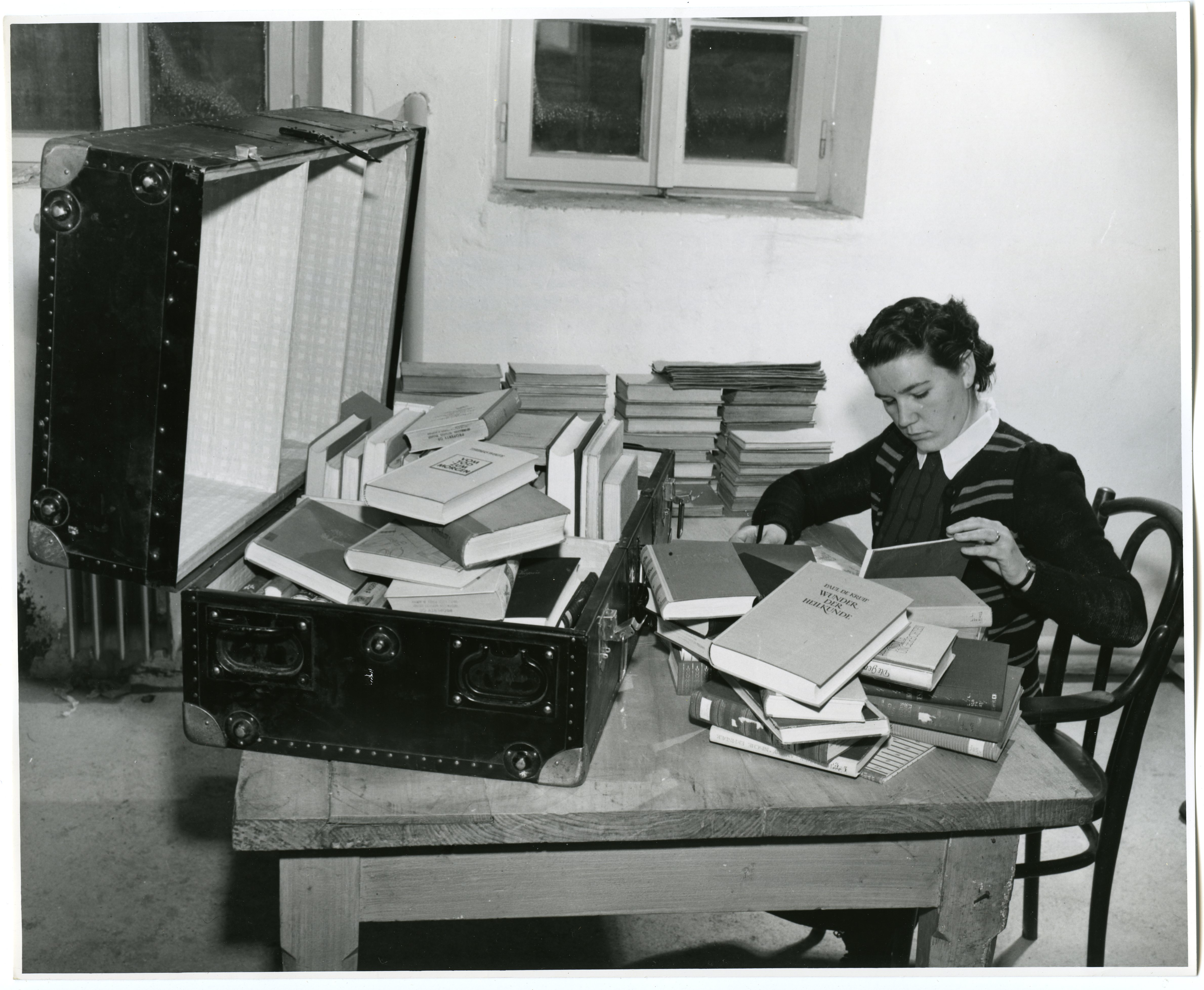Original Caption: The Librarian Carefully Enters the Consignment Into Her Books, 12/1952. Records of the U.S. Information Agency. National Archives Identifier 23932351