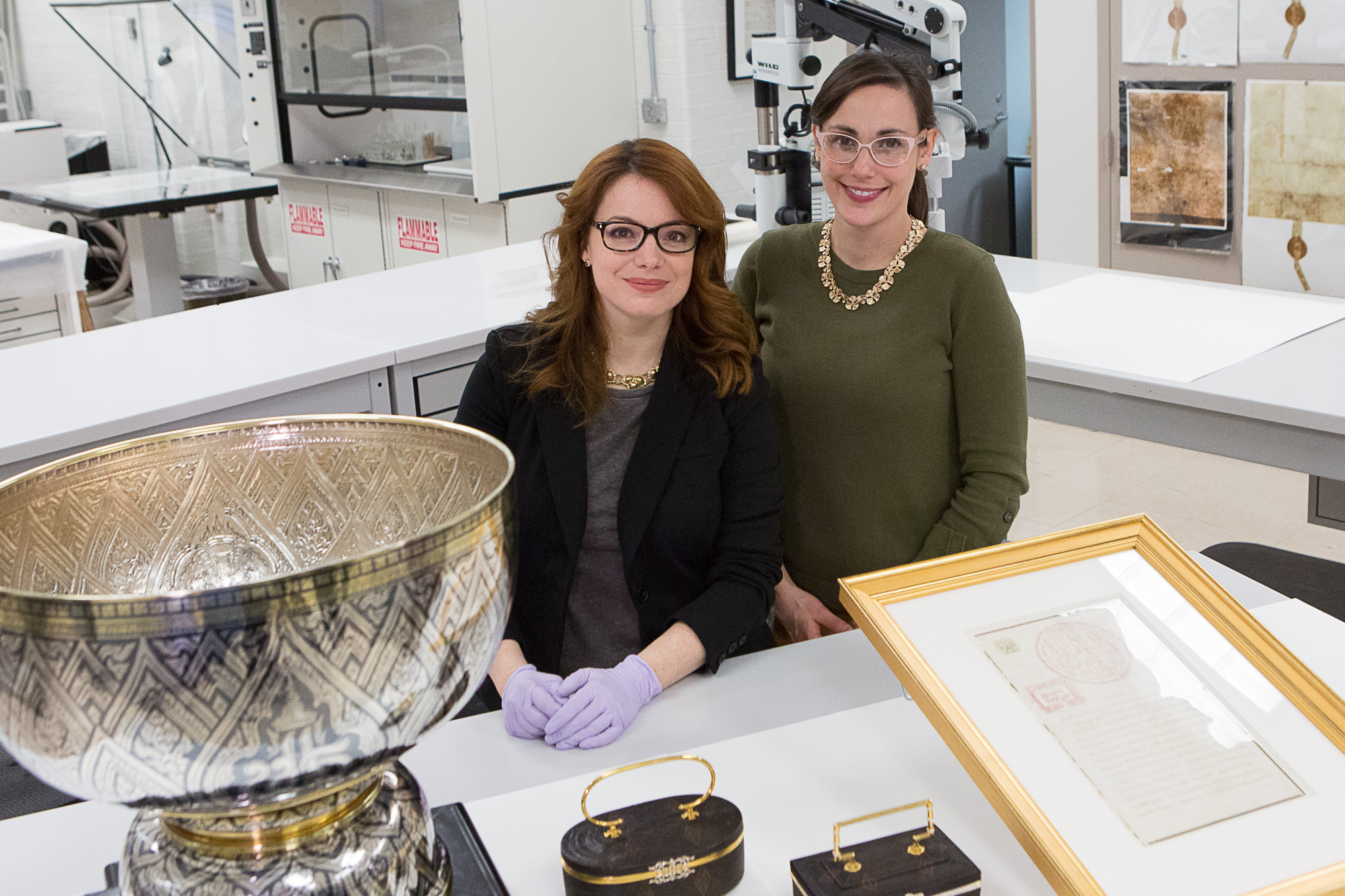 National Archives supervisory conservator Abigail Aldrich and senior conservator Lauren Varga share several items including a silver niello bowl