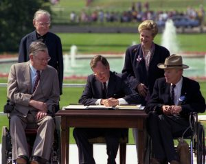 President Bush signs the Americans with Disabilities Act on the South Lawn of the White House,